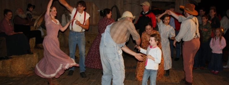 People dancing in barn