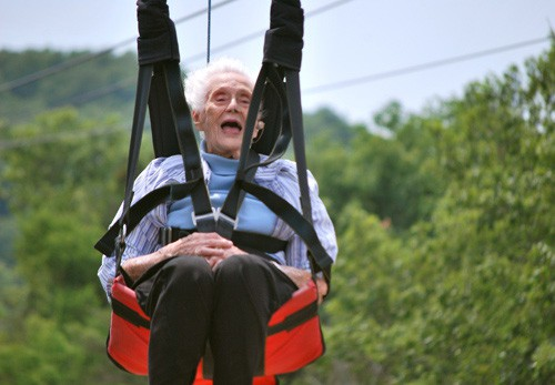 Old woman riding zipline