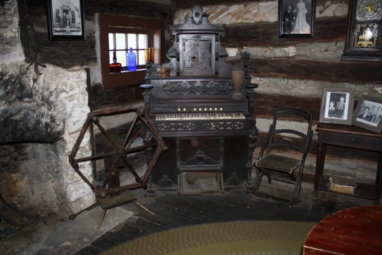 Old piano in the corner of rustic cabin