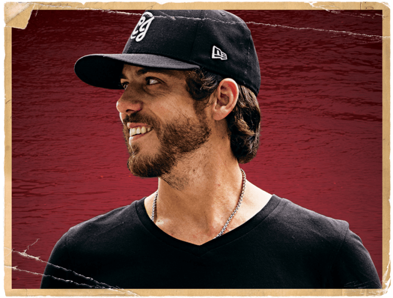 Rustic photo of man with black shirt and black ball cap