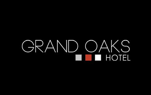 Grand oaks hotel logo