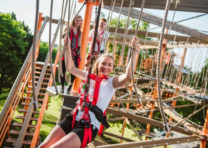 Girl smiling white swinging on ropes course