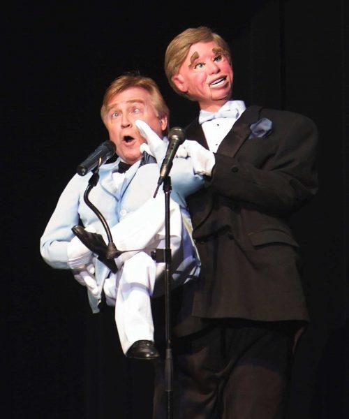Man performing ventriloquist act