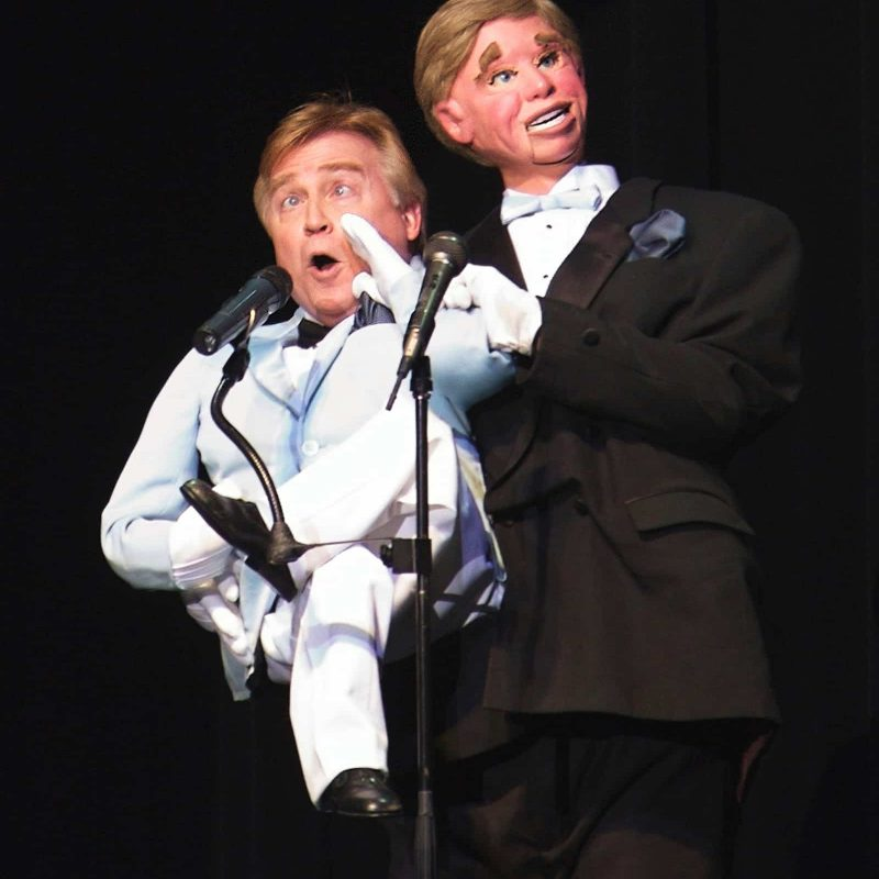 Man performing ventriloquist act