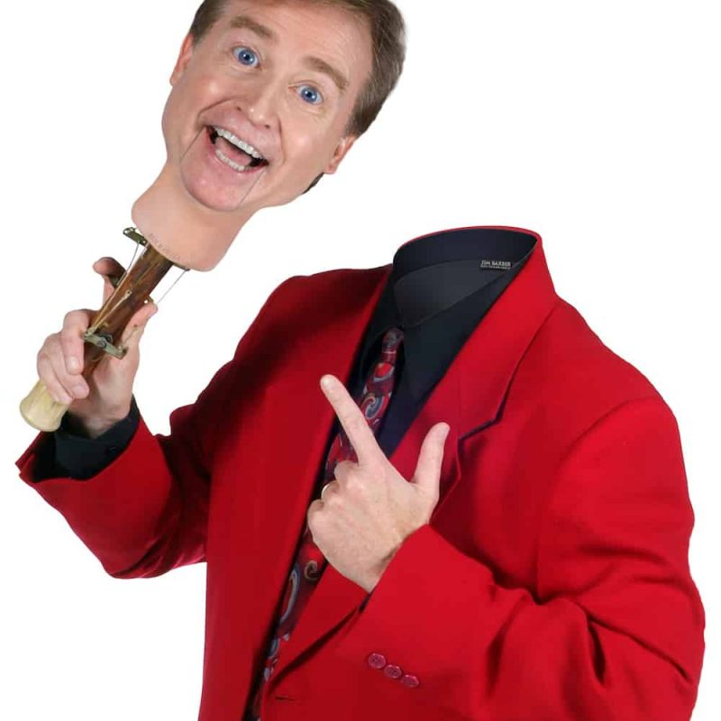 Man in red jacket without head holding puppet head